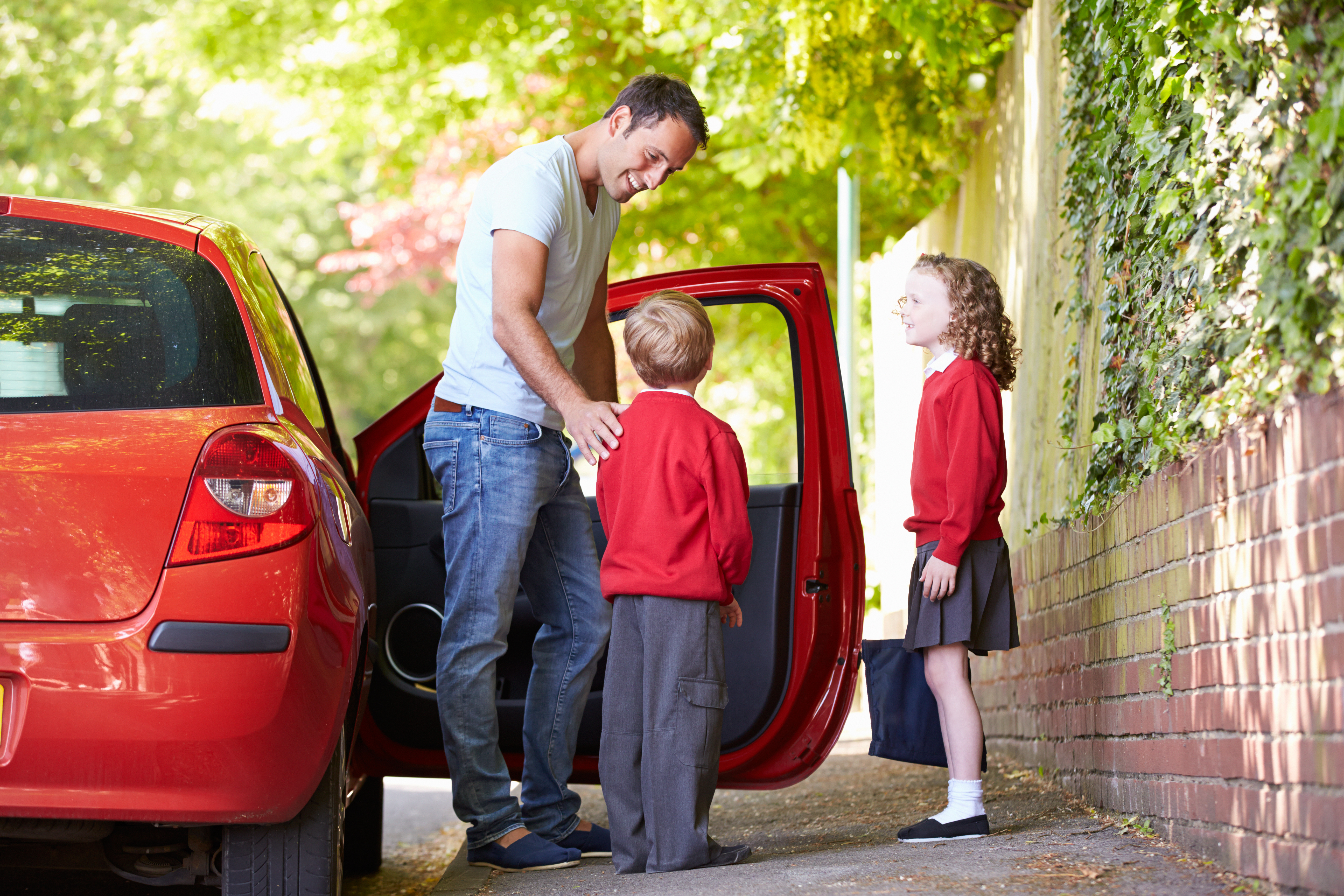 Dad dropping off kids
